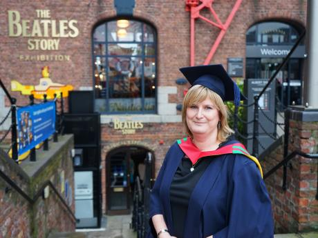 Beatles Master: Beatles Story team member graduates with Beatles masters degree
